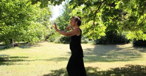 Do Tai Chi in a local park while travelling in China