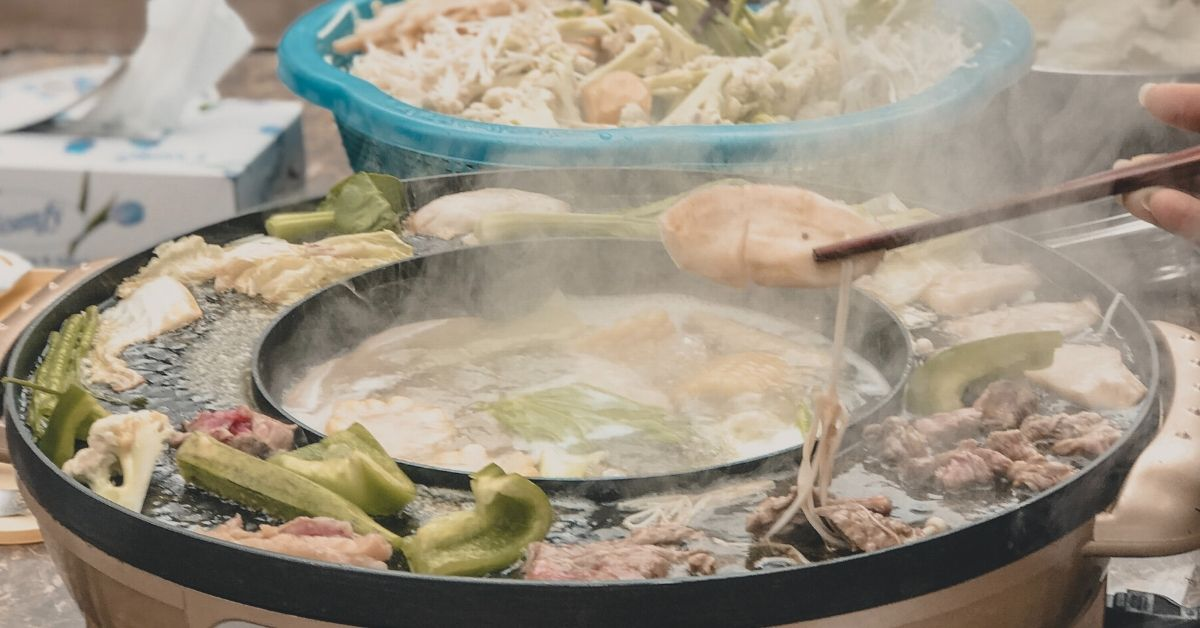 Have hot pot with friends while travelling in China